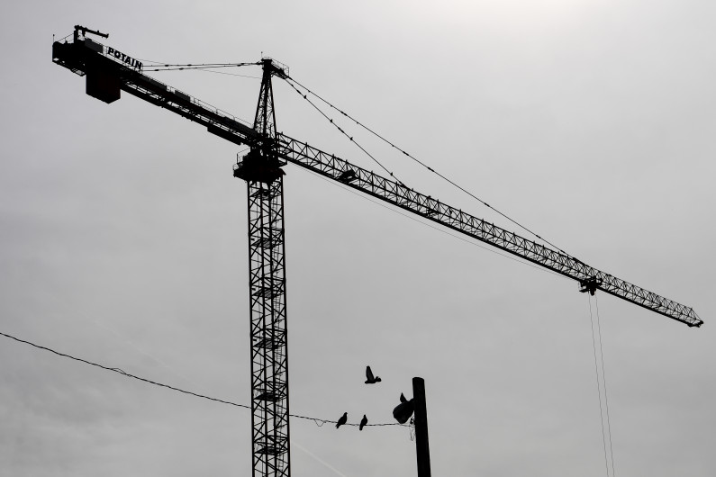 AAron Ontiveroz, The Denver Post Cumming, a cost estimating firm, is predicting that construction spending in metro Denver is headed for an 8 percent decline this year compared to 2018. The bottom isn't dropping out, but metro Denver may have seen a peak to the run-up that began earlier this decade. This crane pictured was active in the River North neighborhood early last year.